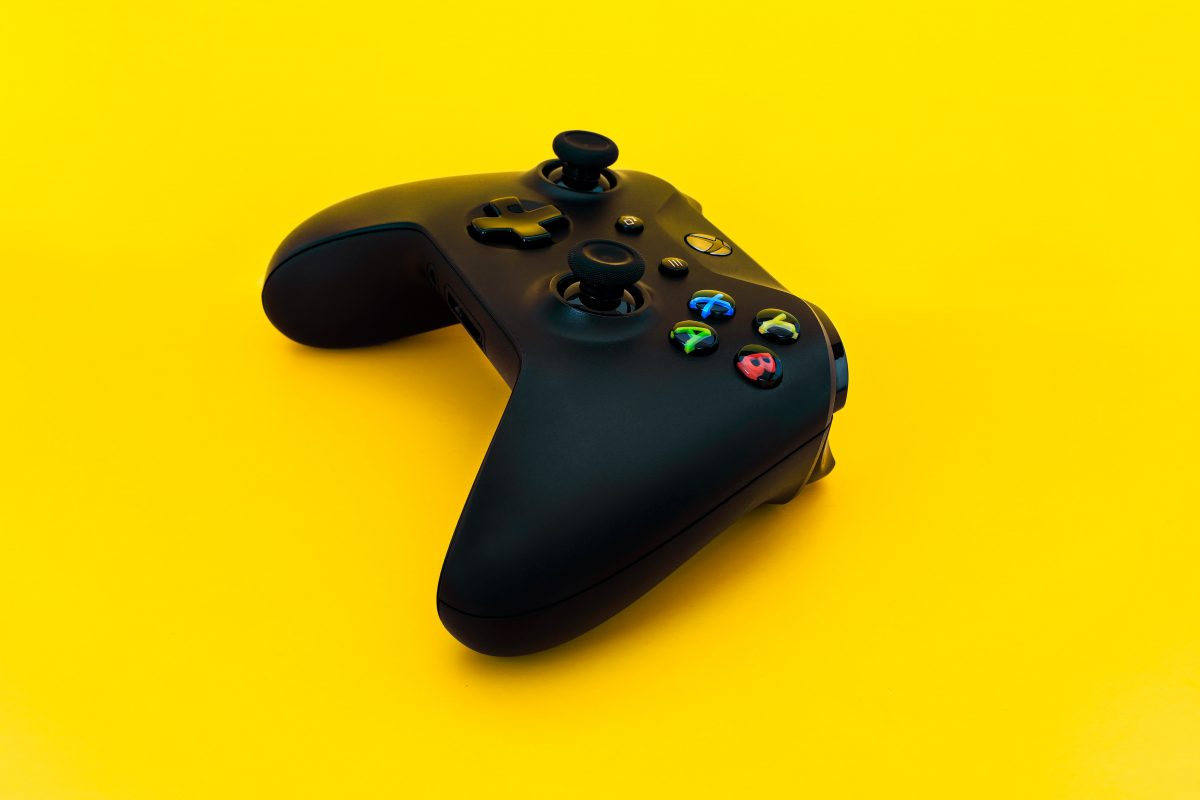 gaming controller on yellow background