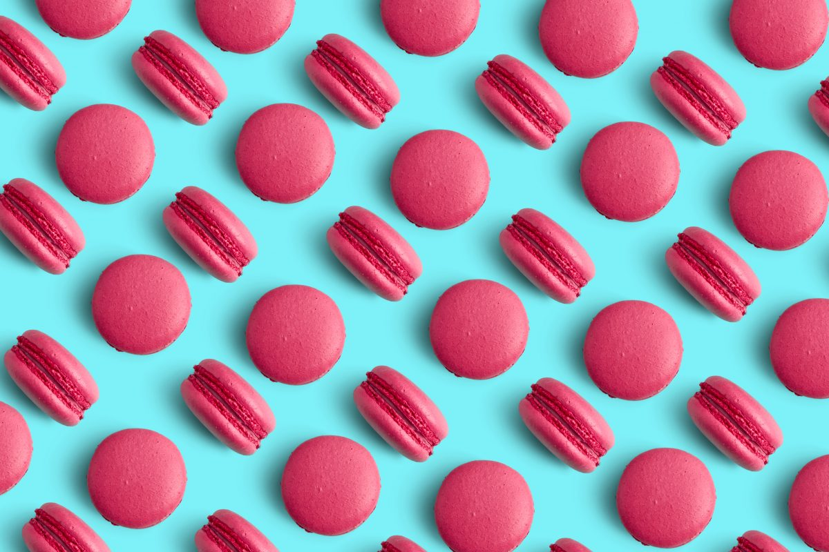 Pink macarons on a blue background